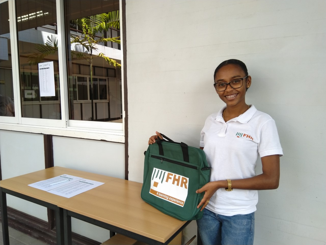 FHR student holding an FHR branded bag